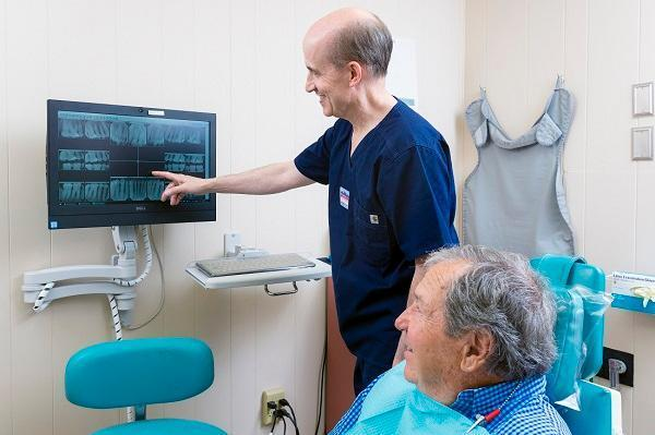Dr. Schriftman showing a dental xray to patient