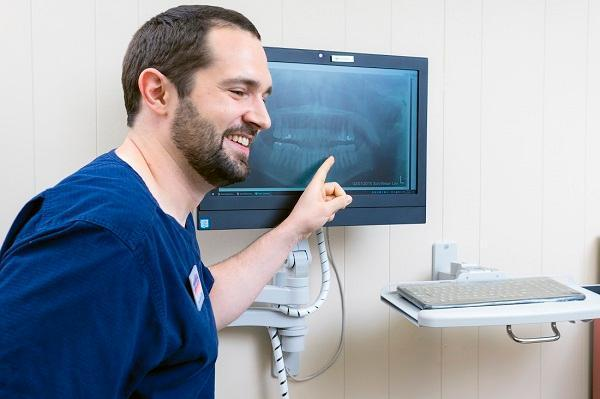 Dentist pointing at xray in Philadelphia