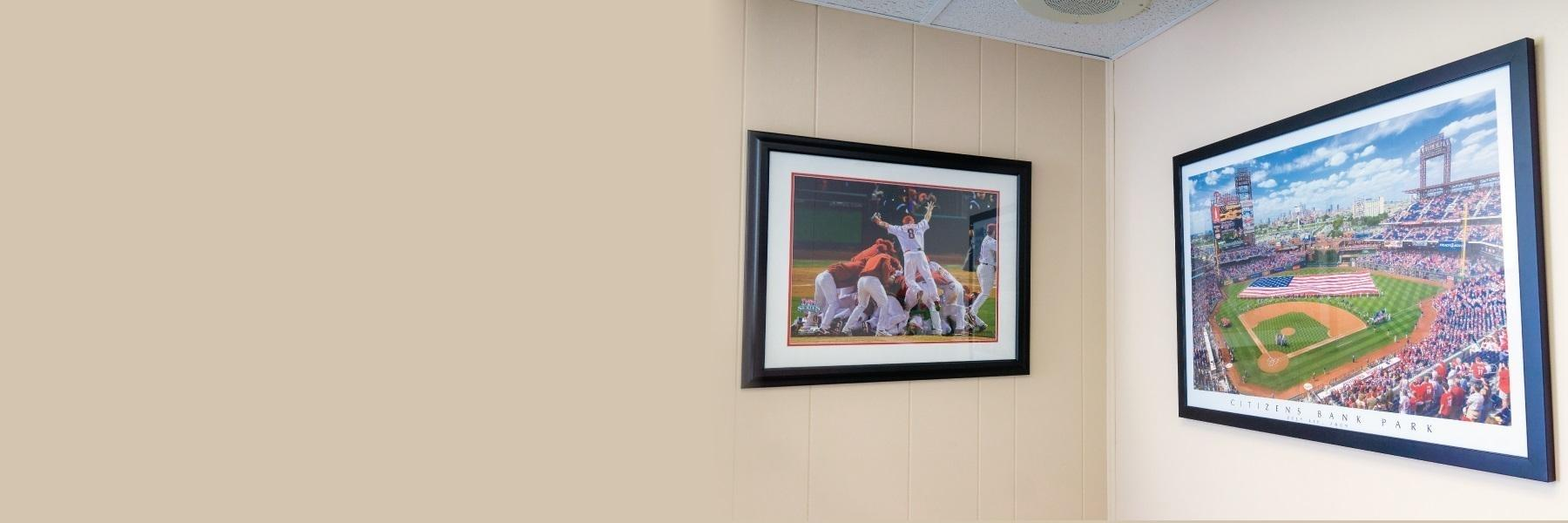 two framed baseball photos on wall of dental office | dental bridge | philadelphia